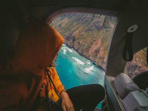 picture of a person looking out a window on helicopter sightseeing tours