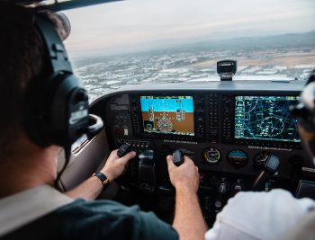 picture of man flying a small airplane by aviation accident lawyer